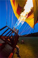 Inflating a hot air balloon near Pokolbin, Hunter Valley, New South Wales, Australia Stock Photo - Premium Rights-Managednull, Code: 700-06675119