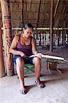 South America, Brazil, Amazonas, Manaus, an indigenous Brazilian woman weaving palm leaves at the Amazonian Peoples Cultural Centre Stock Photo - Premium Rights-Managed, Artist: AWL Images, Code: 862-06675685