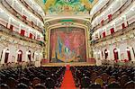 South America, Brazil, Amazonas state, Manaus, the auditorium of the Teatro Amazonas Opera House with a curtain and ceiling painting depicting the Eiffel Tower from beneath by Domenico de Angelis and Giovanni Capranesi Stock Photo - Premium Rights-Managed, Artist: AWL Images, Code: 862-06675697