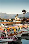 Brazil, Parati, the Portuguese colonial town centre and the church of Saint Rita of Cascia seen from the water with fishing boats on the quay in the foreground Stock Photo - Premium Rights-Managed, Artist: AWL Images, Code: 862-06675766