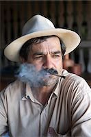 South America, Brazil, Goias, Pirenopolis, a man smoking a Corn Husk Cigarette in the Fazenda Babilonia sugar mill near Pirenopolis, PR, Stock Photo - Premium Rights-Managednull, Code: 862-06676018