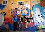 South America, Brazil, Sao Paulo, Vila Madalena, musicians in the Beco do Batman   an alley covered in Brazilian graffiti under the yellow neon glow of the Sao Paulo sky Stock Photo - Premium Rights-Managed, Artist: AWL Images, Code: 862-06676126