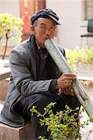 China, Yunnan, Xinping. An elderly man enjoying a peaceful smoke. Stock Photo - Premium Rights-Managednull, Code: 862-06676235