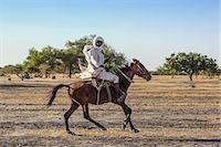 riding crop - Chad, Kanem, Bahr el Ghazal, Sahel. A Kanembu horseman gallops home. Stock Photo - Premium Rights-Managednull, Code: 862-06676373