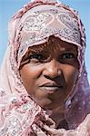 Chad, Kanem, Bahr el Ghazal, Sahel. A Kreda girl wearing a pink headscarf decorated with sequins. Stock Photo - Premium Rights-Managed, Artist: AWL Images, Code: 862-06676375