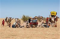 Chad, Batha, Wadi Achim, Sahel. A group of Arab Ouled Sliman nomads pause for water in the desert close to Wadi Achim. Stock Photo - Premium Rights-Managednull, Code: 862-06676387