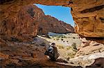 Chad, Elikeo, Ennedi, Sahara. A Toubou man looks out of a massive sandstone cave. Stock Photo - Premium Rights-Managed, Artist: AWL Images, Code: 862-06676420