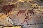 Chad, Taore Koaole, Ennedi, Sahara. A painting of cattle and a man running with a stick or club in hand decorate the sandstone wall of a cave. Stock Photo - Premium Rights-Managed, Artist: AWL Images, Code: 862-06676444