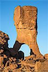 Chad, Abaike, Ennedi, Sahara. A weathered red sandstone column with an arch. Stock Photo - Premium Rights-Managed, Artist: AWL Images, Code: 862-06676447