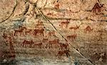 Chad, Bakabi, Ennedi, Sahara. A rock art panel of a figure, perhaps holding saplings, with animals which include Barbary sheep. Stock Photo - Premium Rights-Managed, Artist: AWL Images, Code: 862-06676463