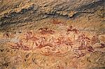 Chad, Terkei East, Ennedi, Sahara. A fine rock art panel on sandstone of galloping horses and their riders Stock Photo - Premium Rights-Managed, Artist: AWL Images, Code: 862-06676483