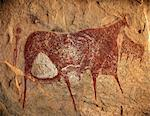 Chad, Terkei East, Ennedi, Sahara. A large bichrome painting of cows and a figure holding a lance on the ceiling of a vast rock shelter. Stock Photo - Premium Rights-Managed, Artist: AWL Images, Code: 862-06676489