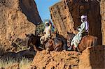 Chad, Barakatra, Ennedi, Sahara. Two young Tubu boys ride their horses among large boulders. Stock Photo - Premium Rights-Managed, Artist: AWL Images, Code: 862-06676492
