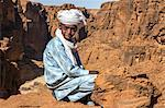 Chad, Wadi Archei, Ennedi, Sahara. A young Toubou boy on a ledge overlooking Wadi Archei. Stock Photo - Premium Rights-Managed, Artist: AWL Images, Code: 862-06676507