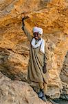 Chad, Wadi Archei, Ennedi, Sahara.  A Toubou boy at the entrance to a large sandstone cave. Stock Photo - Premium Rights-Managed, Artist: AWL Images, Code: 862-06676525