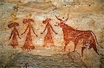 Chad, Terkei West, Ennedi, Sahara.  An ancient painting of three women wearing elaborate dresses and hats beside a cow. Stock Photo - Premium Rights-Managed, Artist: AWL Images, Code: 862-06676528
