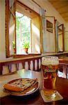 Czech Republic, North Moravia, Zlin, Roznov pod Radhostem, Wallachian Town. Beer and traditional regional cake at the local pub built in traditional Wallachian style Stock Photo - Premium Rights-Managed, Artist: AWL Images, Code: 862-06676582