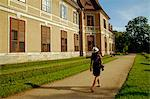 Czech Republic, South Moravia, Rajec Jestrebi. Young woman walking near the Rajec Jestrebi Castle. Stock Photo - Premium Rights-Managed, Artist: AWL Images, Code: 862-06676603