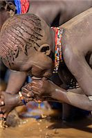 A young Dassanech girl drinking dirty water from the Omo River, Ethiopia Stock Photo - Premium Rights-Managednull, Code: 862-06676726