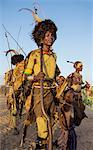 Dassanech men and their wives dressed in ceremonial Dimi regalia participate in a dance, Ethiopia Stock Photo - Premium Rights-Managed, Artist: AWL Images, Code: 862-06676735