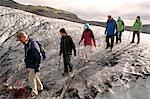 Tourists on a guided hike on Solheimajokull glacier, a tongue of ice that extends from the Myrdalsjokull glacier on Eyjafjallajokull, Iceland. Stock Photo - Premium Rights-Managed, Artist: AWL Images, Code: 862-06676810