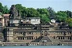 India, Madhya Pradesh, Maheshwar. Below Ahilya Fort and beside the Narmada River's bathing ghats stand elaborate chhatris, or mausouleums, of Ahilya Bai Holkar. Stock Photo - Premium Rights-Managed, Artist: AWL Images, Code: 862-06676814
