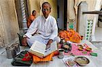 India, Rajasthan, Jaipur. A temple scholar, or pandit, offers advice and performs some rituals for Hindu pilgrims. Stock Photo - Premium Rights-Managed, Artist: AWL Images, Code: 862-06676846