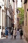 Italy, Lucca. Four cellists walking home through the narrow streets of Lucca after their lesson. Stock Photo - Premium Rights-Managed, Artist: AWL Images, Code: 862-06676877