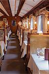 South America, Peru, Cusco, Sacred Valley. The dining car with tables set for dinner on the Orient Express Hiram Bingham train which runs between Cusco and Machu Picchu via Ollantaytambo Stock Photo - Premium Rights-Managed, Artist: AWL Images, Code: 862-06677263