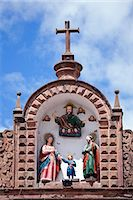 South America, Peru, Cusco. A representation of the holy family   Mary, Joseph and the Christ child with God the father on the roof of the church of Jesus and Mary on the plaza de armas in the UNESCO World Heritage listed former Inca capital of Cusco Stock Photo - Premium Rights-Managed, Artist: AWL Images, Code: 862-06677268