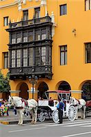 South America, Peru, Lima, a horse and carriage stand in front of a wooden balcony window on the Union Club situated on the main square in the colonial city centre Stock Photo - Premium Rights-Managednull, Code: 862-06677273