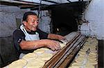 South America, Peru, Ancash, Huaraz. A traditional Peruvian baker with a wood fired oven and loaves of flat bread Stock Photo - Premium Rights-Managed, Artist: AWL Images, Code: 862-06677287