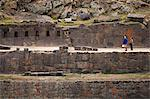 South America, Peru, Cusco, Sacred Valley, Ollantaytambo. Tourists in front of terraces of intricate stonework punctuated with trapezoidal alcoves at the Inca ruins Stock Photo - Premium Rights-Managed, Artist: AWL Images, Code: 862-06677347