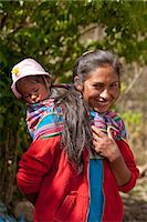 south american woman - South America, Peru, Cusco, Yanama. A Quechua woman from Yanama village in the high Andes with a baby wrapped in a Keperina shawl Stock Photo - Premium Rights-Managednull, Code: 862-06677396