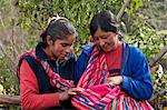 South America, Peru, Cusco. Quechua women in the high Andes admiring a baby wrapped in a Keperina carrying cloth Stock Photo - Premium Rights-Managed, Artist: AWL Images, Code: 862-06677401
