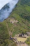 South America, Peru, Cusco, Choquequirao. Terraces, plazas and buildings at the Inca city of Choquequirao built by Tupac Inca Yupanqui and Huayna Capac and situated above the Apurimac valley with mountains of the Salkantay range Stock Photo - Premium Rights-Managed, Artist: AWL Images, Code: 862-06677410