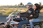 Couple riding a Harley on Highway 20, Bend, Deschutes County, Oregon, USA Stock Photo - Premium Rights-Managed, Artist: AWL Images, Code: 862-06677578