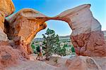 Photographer at Metate Arch, Devils Garden, Grand Staircase National Monument, Colorado Plateau,  Utah,  USA Stock Photo - Premium Rights-Managed, Artist: AWL Images, Code: 862-06677599