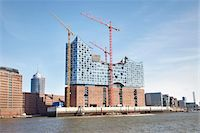flat - Elbe Philharmonic Hall with Construction Cranes on Elbe River, HafenCity, Hamburg, Germany Stock Photo - Premium Rights-Managednull, Code: 700-06679333