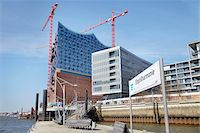 Ferry Dock at Elbe Philharmonic Hall with Construction Cranes, Elbe River, HafenCity, Hamburg, Germany Stock Photo - Premium Rights-Managednull, Code: 700-06679336