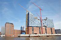 Elbe Philharmonic Hall with Construction Cranes on Elbe River, HafenCity, Hamburg, Germany Stock Photo - Premium Rights-Managednull, Code: 700-06679343