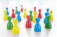 strategy - close-up of multi-colored playing pieces on white background Stock Photo - Premium Rights-Managednull, Code: 700-06679363