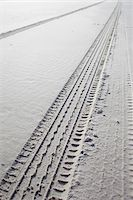 tire tracks in wet sand on the beach Stock Photo - Premium Rights-Managednull, Code: 700-06679365