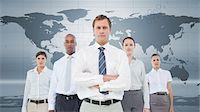 Serious business team standing Stock Photo - Premium Royalty-Freenull, Code: 6109-06684738