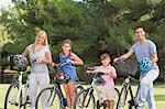 Portrait of smiling family with bikes Stock Photo - Premium Royalty-Free, Artist: Blend Images, Code: 6109-06684779