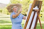 Old woman using easel to paint Stock Photo - Premium Royalty-Free, Artist: Ben Seelt, Code: 6109-06684851