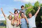 Multi-generation family portrait cheering and having fun Stock Photo - Premium Royalty-Free, Artist: lisafx, Code: 6109-06684944