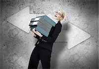 people falling - Woman struggling with work load Stock Photo - Premium Royalty-Freenull, Code: 6109-06684994