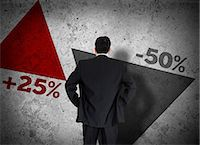 percentage symbol - Businessman looking at statistics Stock Photo - Premium Royalty-Freenull, Code: 6109-06684999