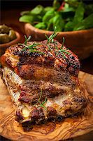 Roasted pork with salad and olives Stock Photo - Royalty-Freenull, Code: 400-06694621